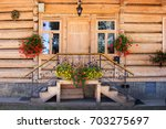 wooden cottage in the chocholow ... | Shutterstock . vector #703275697
