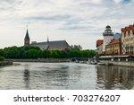 embankment of the pregolya... | Shutterstock . vector #703276207