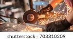 electric wheel grinding on... | Shutterstock . vector #703310209