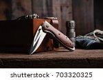 stainless steel folding knife... | Shutterstock . vector #703320325