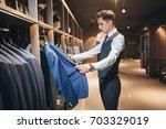 client is an elegant guy... | Shutterstock . vector #703329019