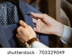 buyer holds the costume collar... | Shutterstock . vector #703329049