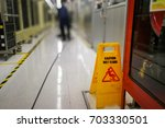 the cleaner cleaning industrial ... | Shutterstock . vector #703330501