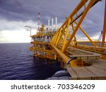oil and gas industrial platform ... | Shutterstock . vector #703346209