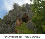 Wide Shot Of A Cave Opening On...