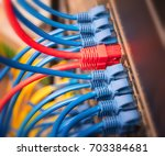 ethernet cables connected to... | Shutterstock . vector #703384681