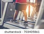 people walking in machine... | Shutterstock . vector #703405861