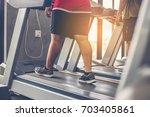 people walking in machine... | Shutterstock . vector #703405861