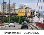 street traffic view entering... | Shutterstock . vector #703406827