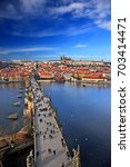 charles' bridge over vltava ... | Shutterstock . vector #703414471