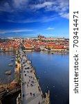 charles' bridge over vltava ... | Shutterstock . vector #703414471