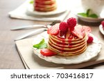 plate with delicious pancakes... | Shutterstock . vector #703416817
