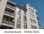 white apartment block at east... | Shutterstock . vector #703417651