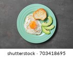 delicious over easy egg with... | Shutterstock . vector #703418695