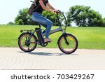 a women riding on electric... | Shutterstock . vector #703429267