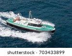 motor boat sailing at the sea | Shutterstock . vector #703433899
