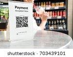 qr code payment   online... | Shutterstock . vector #703439101