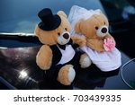 couple of teddy bears put... | Shutterstock . vector #703439335