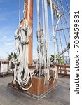 Small photo of Sail Boat Mast Deck Shroud blue sky clouds background