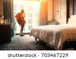 woman backpacker traveler stay... | Shutterstock . vector #703467229