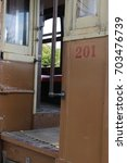 Small photo of Trolley car entry door and steps #201.