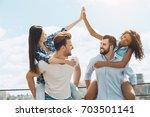 group of friends having... | Shutterstock . vector #703501141