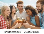 group of friends having... | Shutterstock . vector #703501831