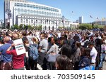 Small photo of San Francisco, CA - August 25, 2017: Hundreds of people gather in support of the Unite Against Hate rally held at Civic Center in front of City Hall. The Mayor and city leaders speak out against hate.
