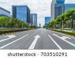 city road through modern... | Shutterstock . vector #703510291