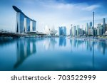 aerial view of singapore... | Shutterstock . vector #703522999