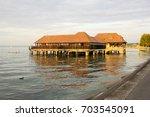 public bathing wooden hut at... | Shutterstock . vector #703545091