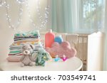 cute knitted toys  baby clothes ... | Shutterstock . vector #703549741