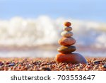 pyramid of colorful  balanced... | Shutterstock . vector #703553647
