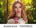 beautiful young woman with... | Shutterstock . vector #703558021