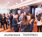 burred conferences and seminars. | Shutterstock . vector #703559821