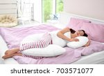 young pregnant woman sleeping... | Shutterstock . vector #703571077