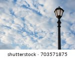 lantern on an iron pillar... | Shutterstock . vector #703571875