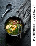 tasty miso soup with salmon on... | Shutterstock . vector #703581739
