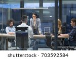 group of a young business...   Shutterstock . vector #703592584