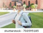outdoor closeup of young trendy ... | Shutterstock . vector #703595185