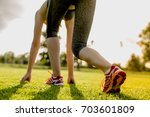 young woman is preparing to run ... | Shutterstock . vector #703601809