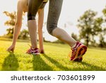 young woman is preparing to run ... | Shutterstock . vector #703601899