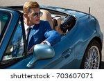 handsome man in the car ... | Shutterstock . vector #703607071