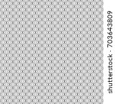 interlocking mini polygons... | Shutterstock .eps vector #703643809