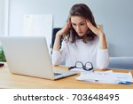 tired young businesswoman... | Shutterstock . vector #703648495