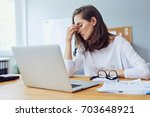 beautiful stressed young office ... | Shutterstock . vector #703648921