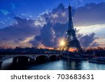 the eiffel tower at sunrise in... | Shutterstock . vector #703683631