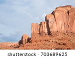 Small photo of Red rocky buttes are clearly stratified with three principle layers.