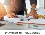architect or engineer using... | Shutterstock . vector #703730587