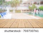 empty wooden table in front... | Shutterstock . vector #703733761